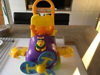 Disney Pooh Bear Ride Along Toy.