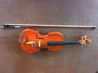 3/4 sized Violin for sale, including 10 music books.