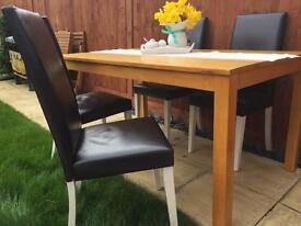 Solid Oak Dining Table with 4 Leather back Chairs