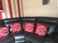 Large black recliner corner sofa + foot rest