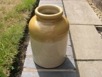 A stoneware storage jar stamped with the name Bailey and Co , London.