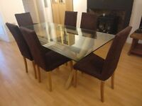 Glass top dining table with oak X base and 6 chairs