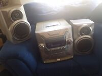 Stereo / Cd Player / Hi-fi / 5 CD changer with radio and 2 tape decks, speakers included.