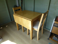 Drop-leaf kitchen table and two chairs