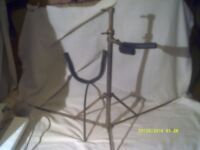A BARITONE SAXOPHONE STAND , FAIRLY LIGHTWEIGHT,, 2 PIECE FOLDING . IT DOES the JOB