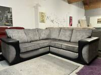 Black leather and grey fabric corner sofa