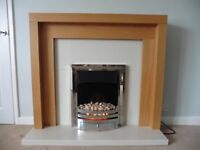 Stunning oak fire surround with pebble chrome electric fire