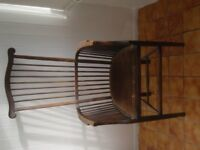Antique High spindleback chair with matching armrests and padded seat.