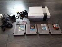 nintendo nes with 4 games all works fine