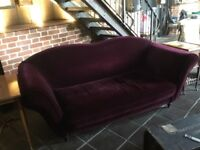 Matched pair of aubergine coloured 3 seater sofas