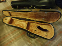 A full sized violin case with carry strap