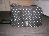 Large Black and White Spotted Holdall with wheels and pull-along handle