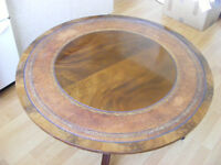 Mahogany veneered round pedestal table with leather inlay