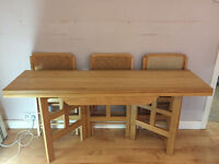 Solid oak dining room table and folding chairs