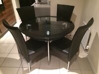 Harvey's glass round table