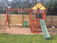 Wooden play frame with swings