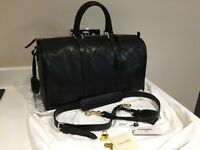 Chanel gym duffle weekend hold-all bag. Genuine black leather