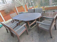 SOLID TEAK PATIO / GARDEN TABLE and SIX ARMCHAIRS.....£549.