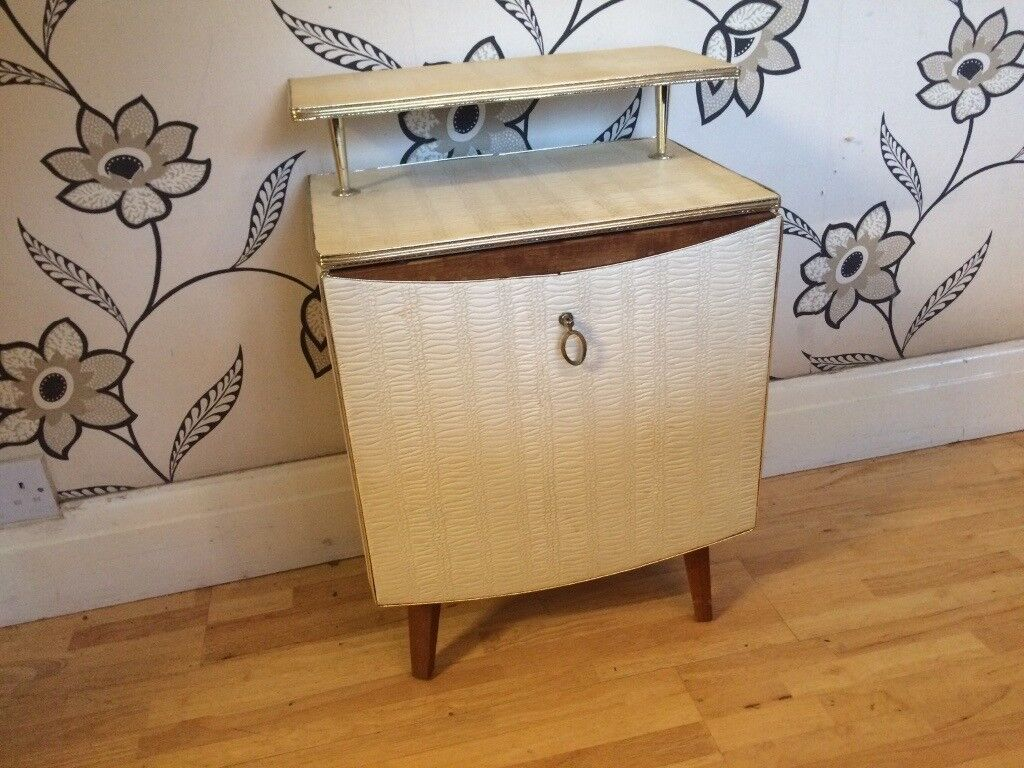 1960'S WHITE PADDED BEDSIDE CUPBOARD WITH SHELF