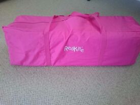Redkite pink travel cot