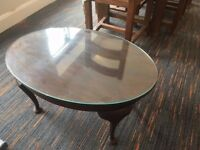 House-Clearance: Solid mahogany coffee table with glass top for sale
