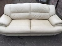 Two Cream Leather Sofas for Sale.