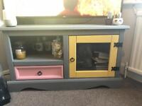 Colourful upcycled tv cabinet