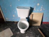 TWO WHITE TOILETS IN CLEAN GOOD WORKING ORDER