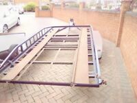 Twin axle trailer/transporter with ramps