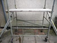 Two Galvanised Steel Scaffolding Towers with safety rails, feet, wheels, boards and stabilisers.