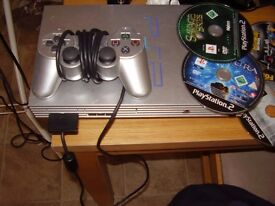 playstation 2 silver with games and 4 player multi tap stand