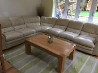 Cream leather corner sofa. Very comfortable. Some worn patches.