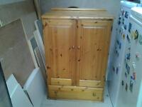 1990's pine wadrobe with large underneath drawer/ could also be used as a multi purpose cabinet