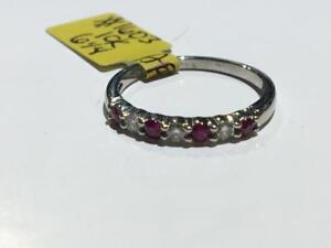 #1603 10K WHITE GOLD RUBY AND DIAMOND STONES! *SIZE 6 1/4* APPRAISED AT $1250.00 SELLING FOR ONLY $425.00!