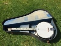 Banjo. Complete with original case. Re skinned and re strung.
