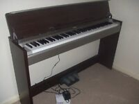 An excellent quality UPRIGHT PIANO from Yamaha- 07802 783986