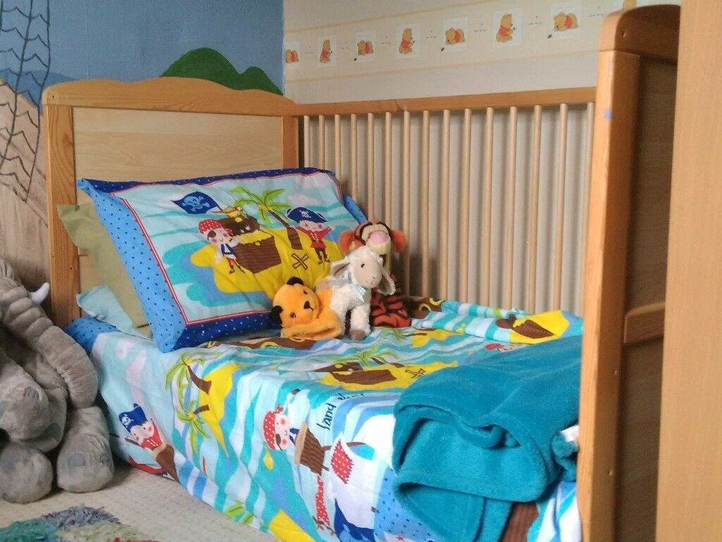Cot/junior bed with mattress, sheet and Winnie the Pooh duvet