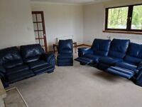 Two 3 seater blue reclining leather sofas.