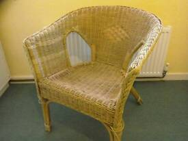 Two cane / wicker armchairs