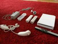 Nintendo Wii console + remotes
