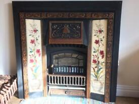 Vintage cast iron fireplace surround with electric fire
