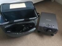 In focus projector with carry case