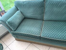 Sofa with drop down arms and Armchair in hard wearing green fabric. Good condition