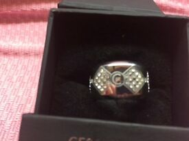 CERUTTI ring brand new unused, still boxed. Cost £111.00 from amazon. Size 7/8