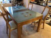 Dining table, four chairs, sideboard and side table
