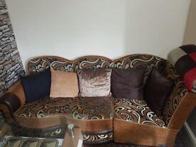 Corner sofa with Glass table