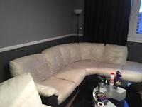 White and brown leather corner sofa and foot stool and electric recliner