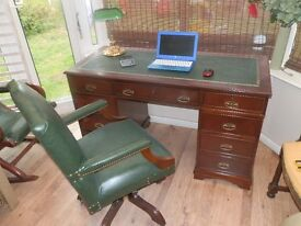 Reproduction Antique Style Leather Desk, with matching Captain's chair, both in great condition.