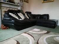 Smaller black leather corner sofa