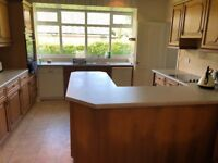 Good quality used wood kitchen with selection of drawers and cabinets